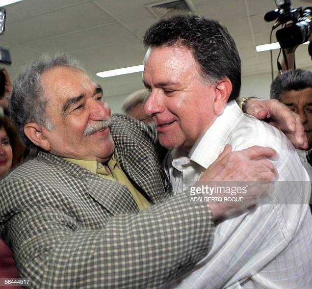 The head of the Colombian delegation peace commissioner Luis Carlos Restrepo and Colombian writer Gabriel Garcia Marquez embrace prior to holding the...