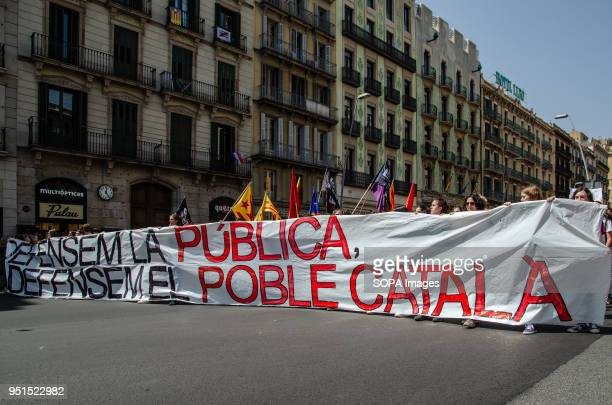 The head of the demonstration seen walking through Pelai street of Barcelona with a large banner and independence flags Thousands of Catalan...