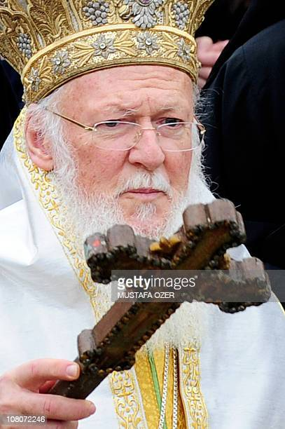 The head of the Eastern Orthodox Church Ecumenical Patriarch Bartholomew holds the wooden cross near the Golden Horn after a mass as part of...