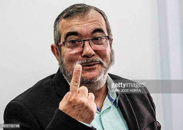 The head of the FARC guerrilla Timoleon Jimenez aka Timochenko gestures during a press conference in Bogota on November 25 2016 Colombia's government...