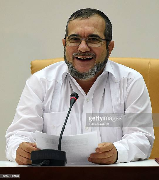 The head of the FARC guerrilla Timoleon Jimenez aka Timochenko speaks during a meeting with Colombian President Juan Manuel Santos in Havana on...