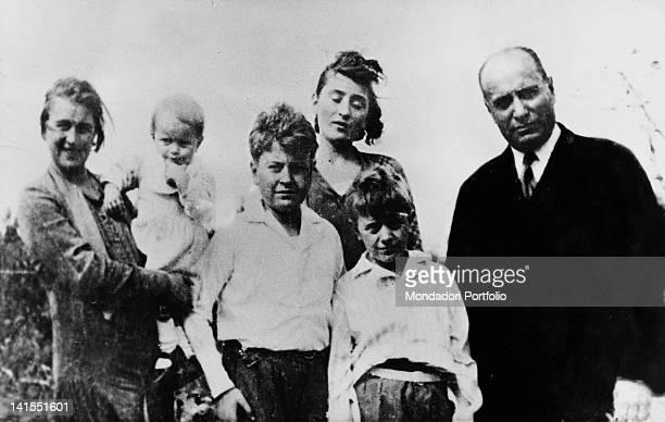 The head of the Fascist government Benito Mussolini smiling with wife Rachele and children Romano Edda Bruno and Vittorio Italy 1928