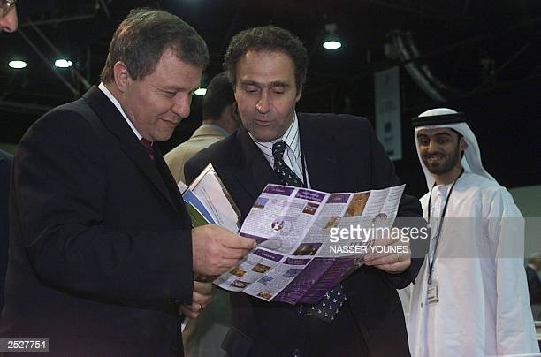 The head of the Israeli delegation minister without portfolio at the ministry of finance Meir Sheetrit looks at a map of Dubai with an unidentified...