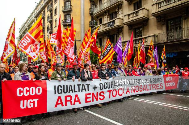 The head of the manifestation of the big unions UGT and CCOO descends by Vía Laitana de Barcelona with a big banner with the slogan equality...