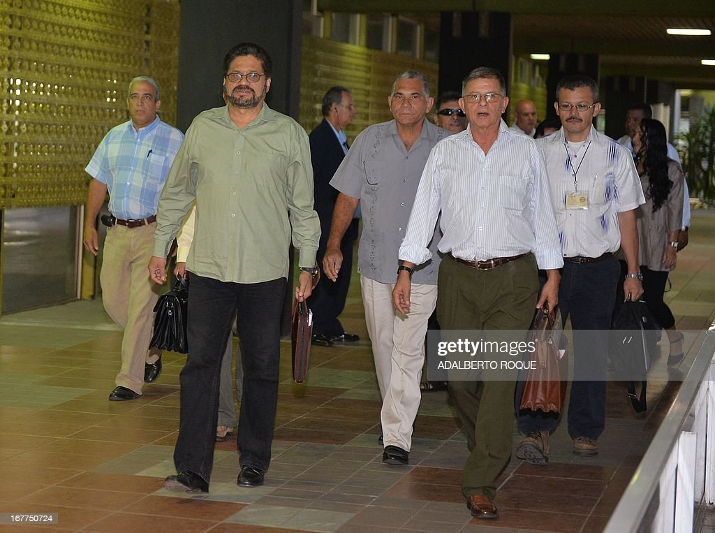 The head of the Revolutionary Armed Forces of Colombia (FARC) guerrilla delegation, commander Ivan Marquez (front, L) and commander Rodrigo Granda (front, R in front) arrive at the Conventions Palace in Havana for the peace talks with the Colombian Government, on April 29, 2013. Colombian peace talks designed to end Latin America's last and oldest insurgency resumed on April 23 after a month's recess. Since the negotiations began on November 19, only the first item on the agenda -- land reform -- has been addressed although the rebels have suggested some 100 other measures.