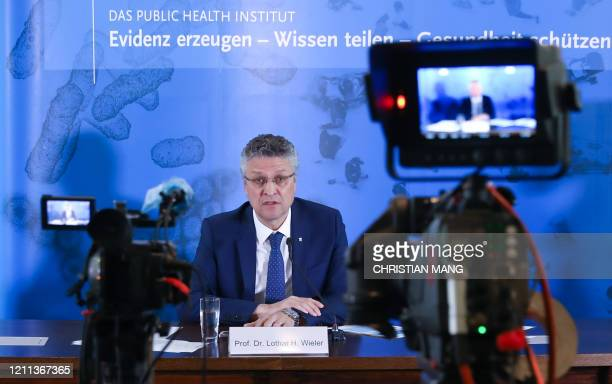 The head of the Robert Koch Institute Lothar Wieler addresses a news conference on the country's situation amid the novel coronavirus COVID19...