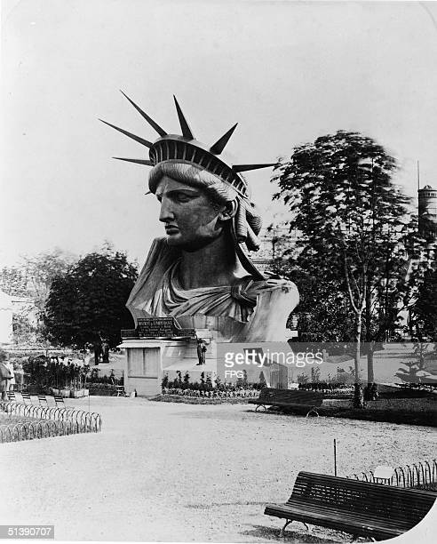The head of the Statue of Liberty on display in the garden at the Champ de Mars at the World's Fair in Paris to drum up support and contributions for...