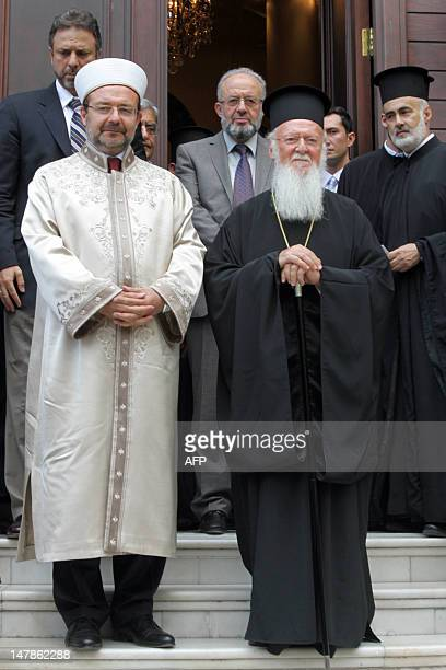 The head of Turkey's Religious Affairs Directorate Mehmet Gormez and Ecumenical Patriarch of Constantinople Bartholomew pose after their meeting at...