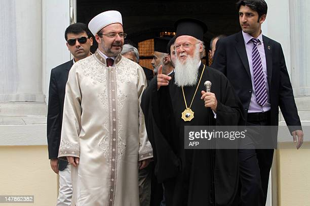 The head of Turkey's Religious Affairs Directorate Mehmet Gormez and Ecumenical Patriarch of Constantinople Bartholomew talk after their meeting at...