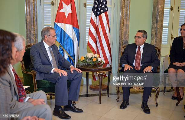 The head of US Interest Section Jeffrey DeLaurentis talks with Cuban Foreign ViceMinister Marcelino Medina before giving him a letter from US...