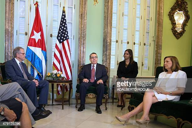 The head of US Interest Section Jeffrey DeLaurentis talks with Cuban Foreign ViceMinister Marcelino Medina after giving him a letter from US...