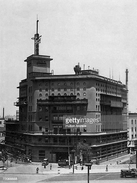 The head office of Asahi Shimbun News, near Ginza in Tokyo, circa 1925. Designed by architect Kikuji Ishimoto the building was originally painted...