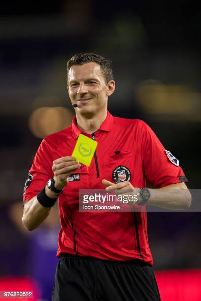 The head official gives Orlando Pride forward Sydney Leroux a yellow card during the soccer match between The Orlando Pride and Sky Blue FC on June...