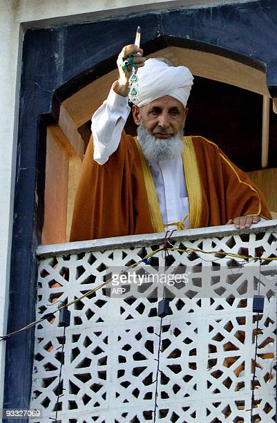 The head priest of the Hazratbal Shrine displays the holy relic believed to be a hair from the beard of the Prophet Mohammed on the Friday following...