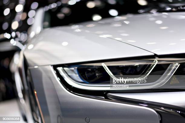 The headlight of a Bayerische Motoren Werke AG i8 plugin coupe vehicle is seen during the 2018 North American International Auto Show in Detroit...