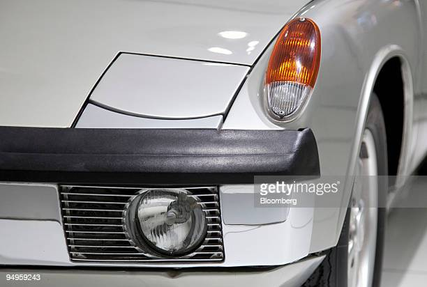 The headlight of a Porsche 914/8 automobile is seen on display at the exhibition