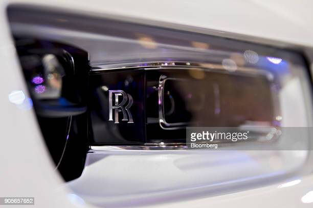 The headlight of a RollsRoyce Motor Cars Ltd 2018 Phantom vehicle is seen during the 2018 North American International Auto Show in Detroit Michigan...