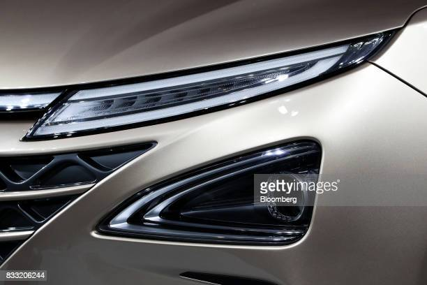 The headlights of a Hyundai Motor Co next generation fuelcell electric sport utility vehicle are displayed during an unveiling event in Seoul South...