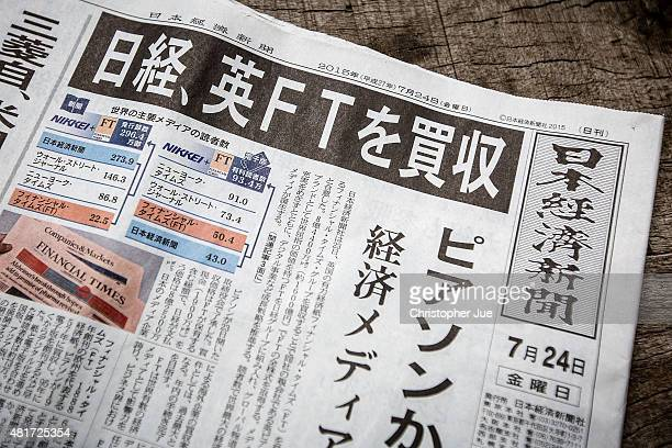 The headline news of the Nikkei newspaper states that the Nikkei will buy the Financial Times on July 24 2015 in Tokyo Japan Japanese media group...