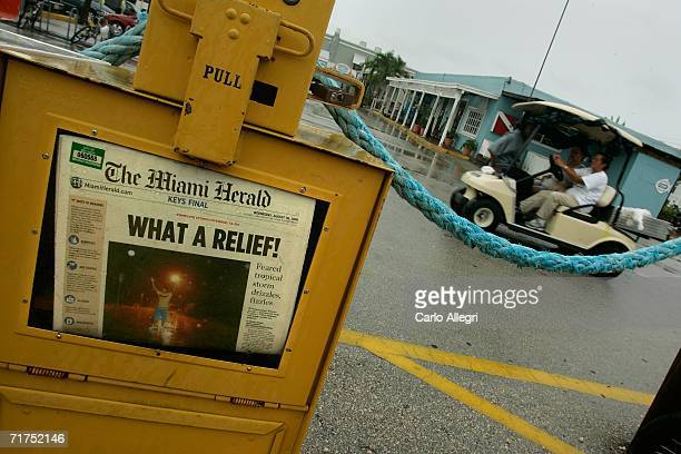The headline of the Miami Herald inside a sidewalk newspaper box reflects the turn of events in South Florida as Tropical Storm Ernesto remained...