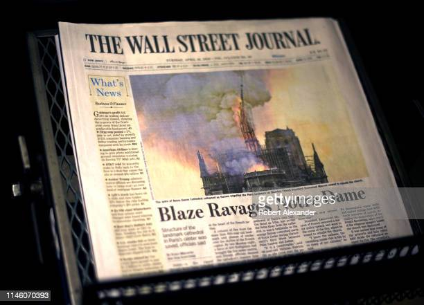 The headline on the April 16 2019 edition of The Wall Street Journal declares a 'blaze ravages Notre Dame' Cathedral in Paris France