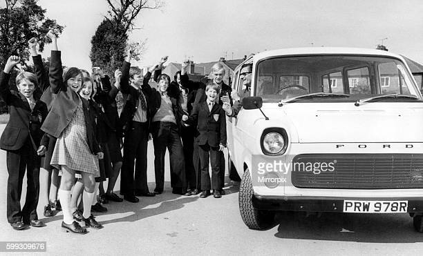 The headmaster of the Blue Coat School Coventry Mr WJ Grimes tries out the new 12seater bus to the cheers of some of the pupils who helped to raise...