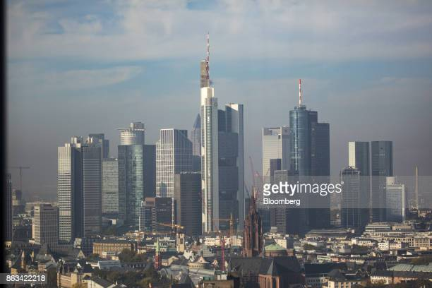 The headquarter offices of Commerzbank AG, center, stand flanked by other skyscraper buildings in the financial district in Frankfurt, Germany, on...