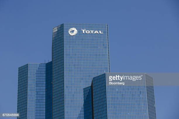 The headquarter skyscraper offices of Total SA stand in La Defense business district of Paris France on Wednesday April 19 2017 French companies are...