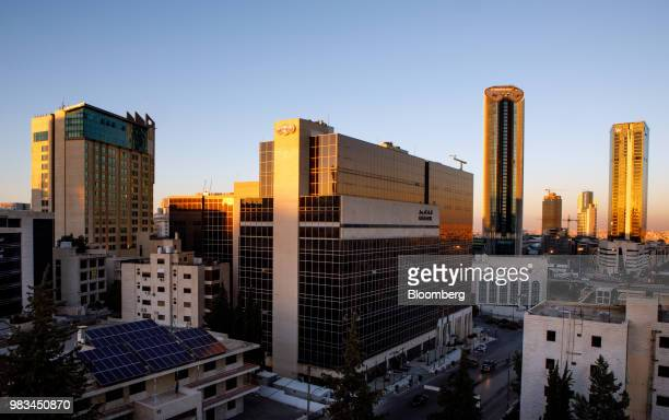 The headquarters of Arab Bank Plc center and Al Abdali district sits on the city skyline during sunset in Amman Jordan on Thursday June 21 2018...