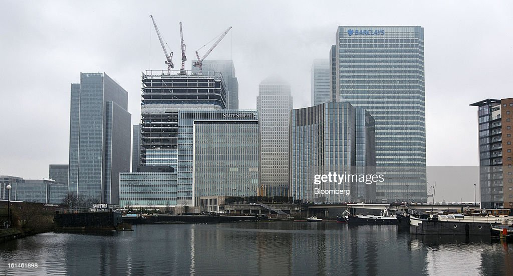 The headquarters of Barclays Plc, right, stands amongst commercial real estate and offices in the Canary Wharf business and financial district in London, U.K., on Monday, Feb. 11, 2013. Barclays Plc Chief Executive Officer Antony Jenkins's pledges to shred the legacy of his predecessor and fix the lender's culture are distracting from the difficulty he has in reviving profit at Britain's biggest investment bank. Photographer: Jason Alden/Bloomberg via Getty Images