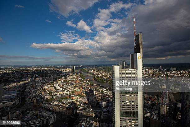 The headquarters of Commerzbank AG stand in the financial district as commercial and residential properties stand beyond in Frankfurt Germany on...