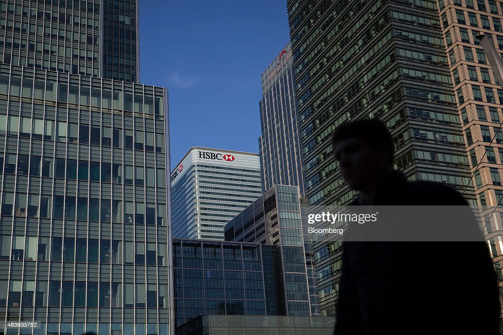 The headquarters of HSBC Holdings Plc, center, stands between the