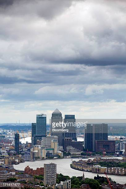 The headquarters of HSBC Holdings Plc left No 1 Canada Square or Canary Wharf Tower center and Citigroup Inc's offices are seen from the Swiss Re...