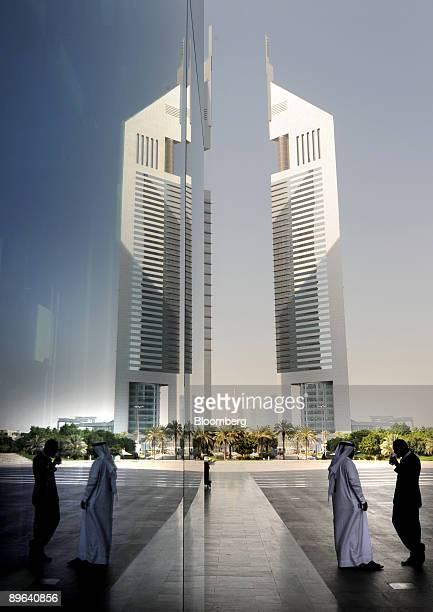 The headquarters of Shuaa Capital PSC sits on level 28 of the Emirates Tower and is reflected in the window of the Dubai International Financial...