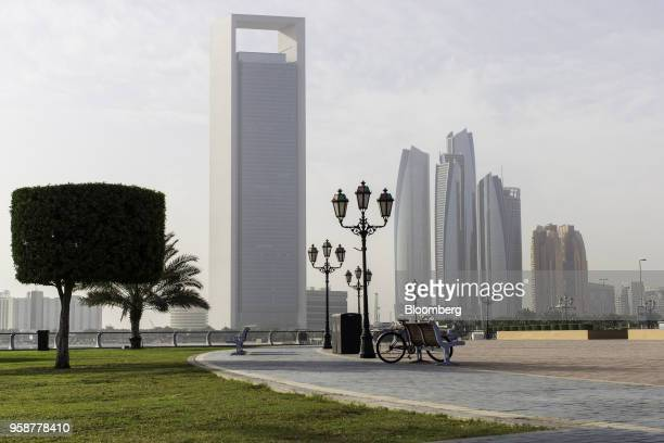 The headquarters of the Abu Dhabi National Oil Company left stands in Abu Dhabi United Arab Emirates on Thursday Feb 22 2018 Adnocis seeking to...