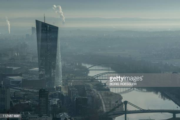 The headquarters of the European Central Bank can be seen next to the river Main as morning fog hangs over Frankfurt am Main western Germany on...