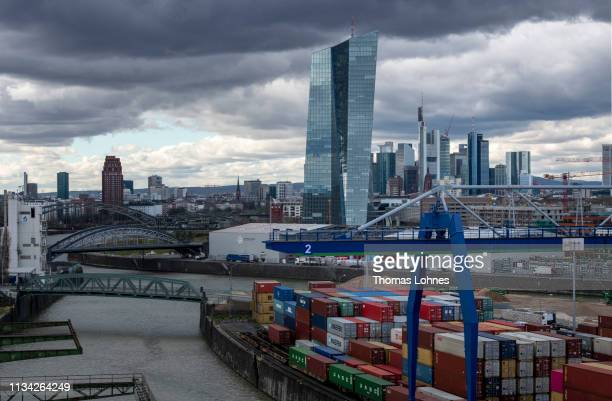 The headquarters of the European Central Bank in front of the Frankfurt skyline with the finance district the river Main and the container harbor...