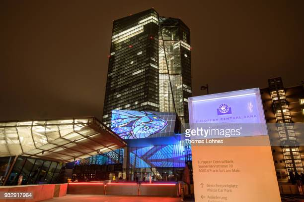 The headquarters of the European Central Bank stands illuminated during a rehearsal for the upcoming Luminale festival on March 16 2018 in Frankfurt...