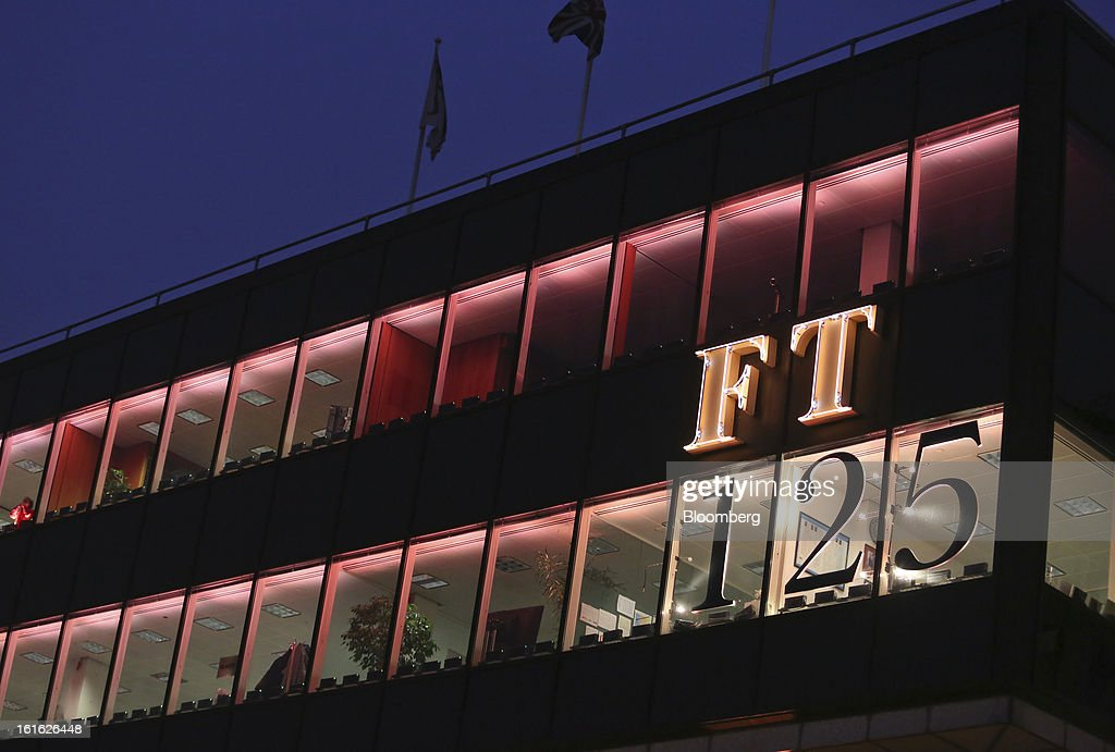 The headquarters of the Financial Times newspaper are bathed in pink light to mimic the color of the publication's paper, as part of their 125th anniversary celebrations, in London, U.K. on Wednesday, Feb. 13, 2013. Pearson Plc, owner of the Financial Times newspaper, cut its forecast for 2012 and predicted a difficult 2013, as tougher market conditions hit earnings at its professional education and FT Group units. Photographer: Chris Ratcliffe/Bloomberg via Getty Images
