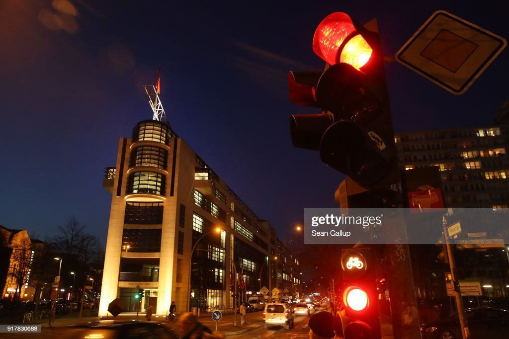 The headquarters of the German Social Democrats (SPD) stands illuminated as the SPD leadership was meeting inside on February 13, 2018 in Berlin, Germany. The party is currently in crisis, with its popularity plummeting in polls down to under 17% following chaos in its leadership. Party leader Martin Schulz had initially promised to step down and had announced SPD Bundestag faction leader Andrea Nahles would take his place, though a hard front of SPD members have since positioned them against Nahles, making the leadership succession question now uncertain.