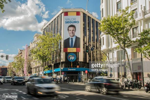 The headquarters of the popular party seen with a gigantic photograph of its candidate for the presidency Pablo Casado. At midnight the election...