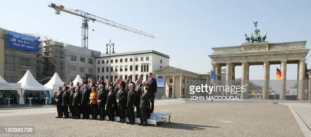 The heads of state of the 27 European Union nations pose for a family photo around German Chancellor Angela Merkel whose country currently holds the...