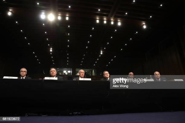 The heads of the United States intelligence agencies Acting FBI Director Andrew McCabe Central IntelligenceÊAgency Director Mike Pompeo Director of...