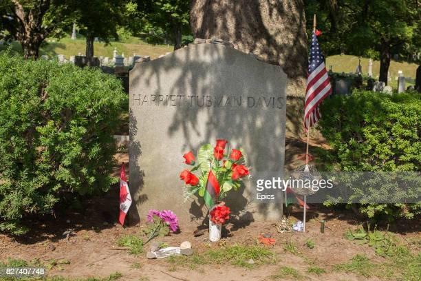 The headstone and flowers at the grave of American abolitionist and humanitarian Harriet Tubman at the Fort Hill cemetery Auburn New York