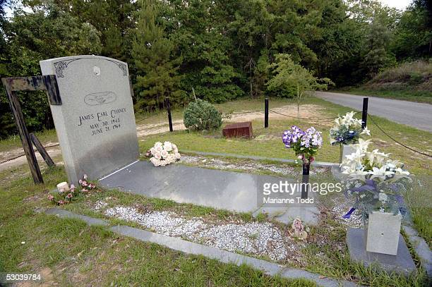 The headstone of black civil rights worker James Chaney is held in place with metal supports along a rural road more than forty years after his...
