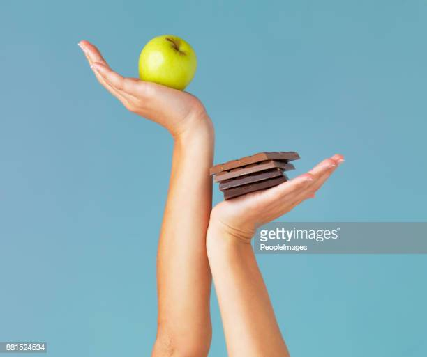 the healthy choice is in your hands - temptation stock pictures, royalty-free photos & images