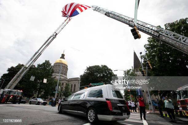 The hearse and funeral procession for civil rights icon, former US Rep. John Lewis arrives at the Georgia State Capitol on July 29, 2020 in Atlanta,...