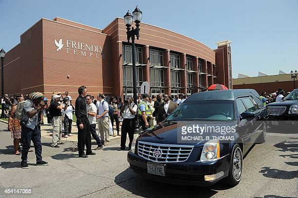The hearse bearing the casket of slain 18yearold Michael Brown Jr departs for the cemetery following funeral services at Friendly Temple Missionary...