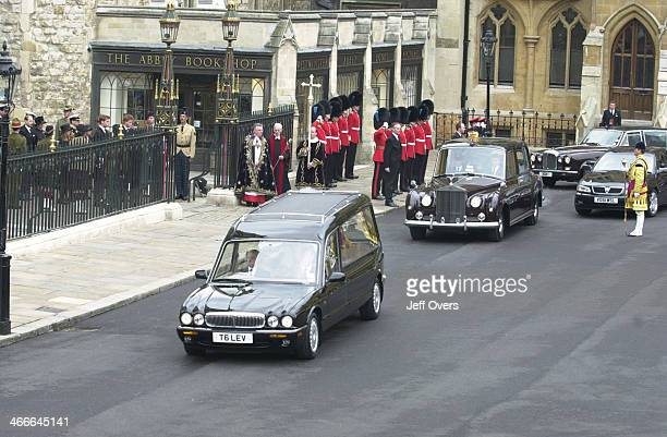 The hearse car carrying the coffin of Queen Elizabeth the Queen Mother leaves Westminster Abbey after her funeral service