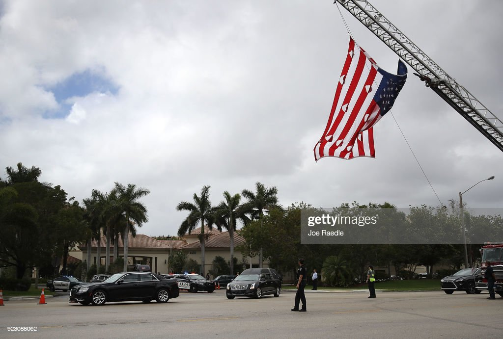 The hearse carrying Aaron Feis who was the football coach at Marjory Stoneman Douglas High School heads to the cemetery after his funeral at Church by the Glades on February 22, 2018 in Coral Springs, Florida. Mr. Feis was killed along with 16 other people by 19 year old former student Nikolas Cruz at the high school on February 14th.